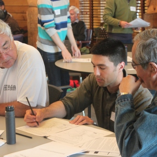 Working with Heiltsuk fisherman Keith Gladstone during a fisheries workshop in Bella Bella.